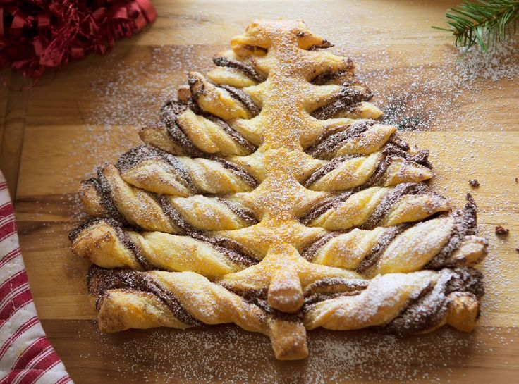 Creating a fun and festive dessert for Christmas doesn't have to take forever! All you need is store-bought puff pastry and a jar of chocolate hazelnut spread and you have a show-stopping treat that everyone will love! To make this you will need: 1 package Puff Pastry thawed according to package directions (2 individual pastry...