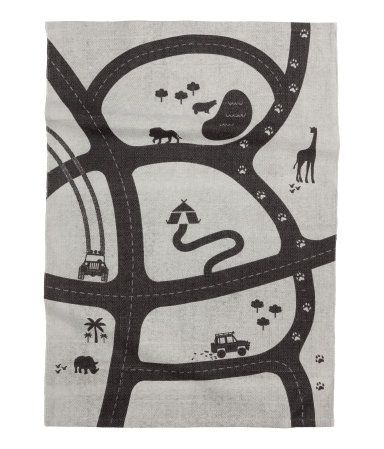 Light gray/car track. Cotton rug with a printed motif at front and non-slip protection at back.