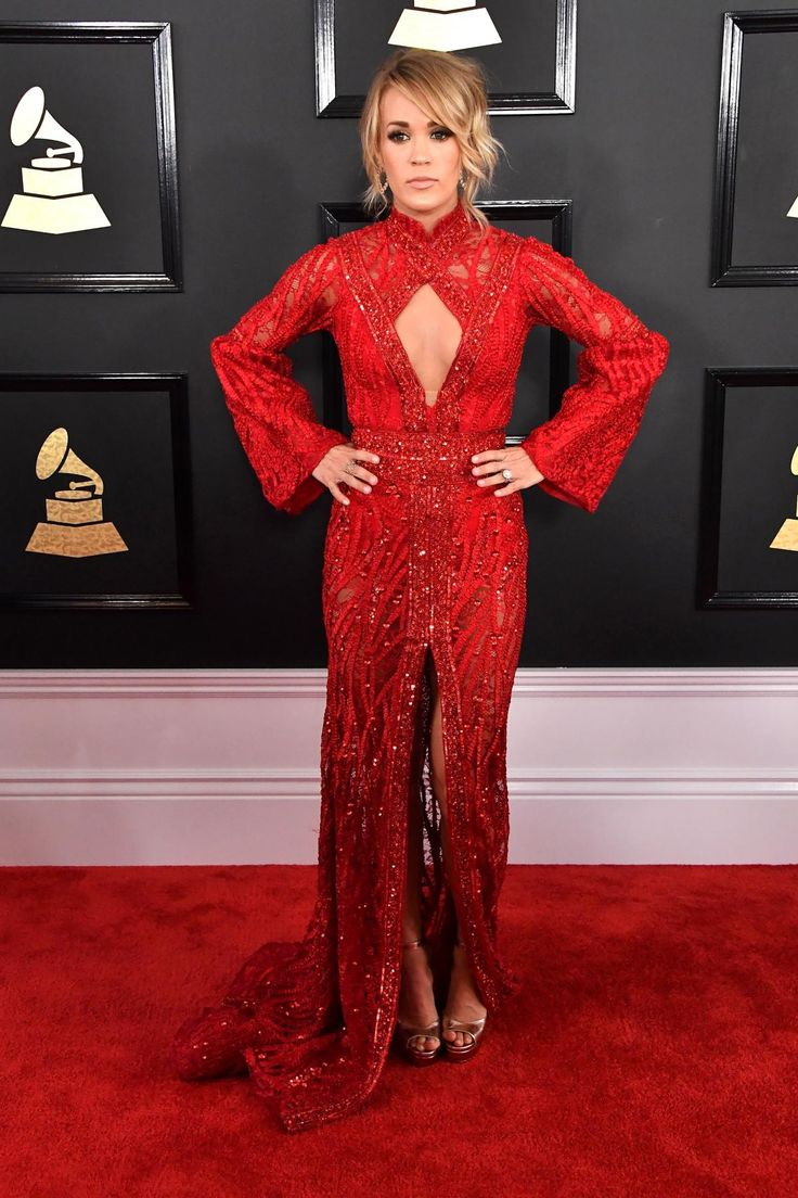 """Singer Carrie Underwood, who was nominated for the Best Country Solo Performance award at the show, donned a striking Elie Madi dress at the Grammy Awards. Later in the evening, she performed her new song with Keith Urban """"The Fighter."""""""