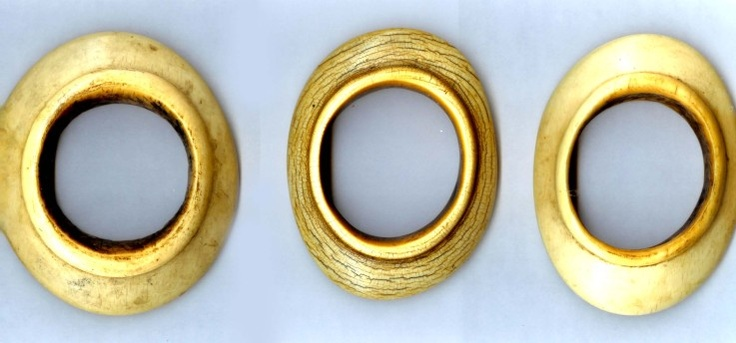 Africa | Three ivory bangles with concave shape worn by the Nuer, Sudan.