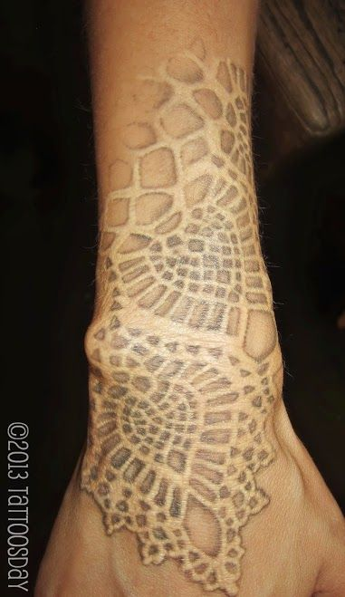 Tattoosday (A Tattoo Blog): Tina's Lovely Lace Tattoo  I love how they shadowed the white with the gray