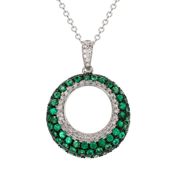 A unique Tsavorite and diamond circle pendant.  Tsavorite's are one of the only other gemstones that has the same lustre as diamond, Adamantine.  Hence the vibrant colour to enhance any outfit!  Also available in the monotone design of black and white diamonds