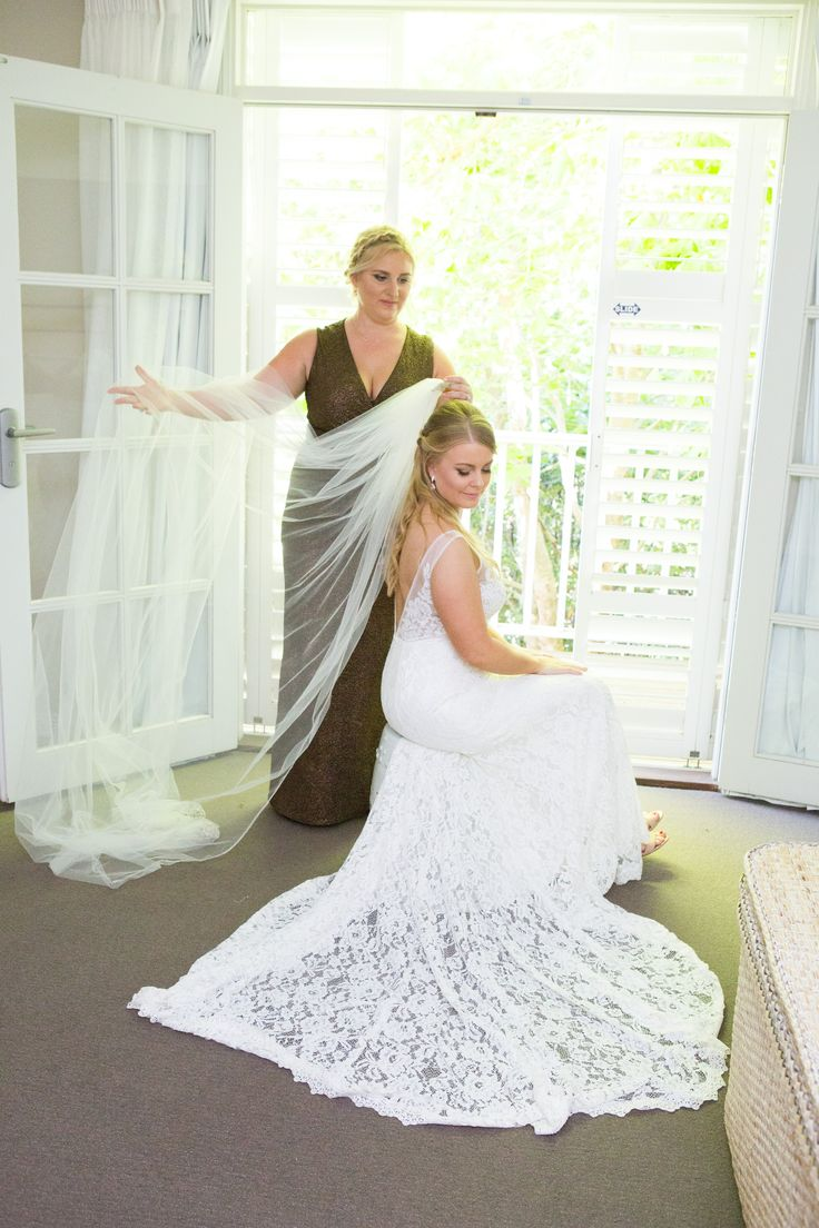 Beautiful lace train and tulle veil PC: Liv Style photography
