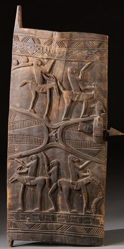 Africa | Large carved door panel. More than likely to come from West Africa.