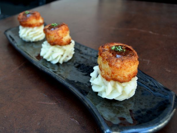 """Katana Robata and Sushi Bar : 8439 W. Sunset Blvd., West Hollywood, CA  This iconic Japanese restaurant pairs its mashed potatoes with pan-fried scallops and yuzu, a type of citrus fruit. The dish is part of the prix fixe """"Izakaya"""" Feast. Katana kitchen manager Raul Salinas says: """"The heart and soul of Katana is really Japanese comfort food, and nothing says comfort like mashed potatoes! The scallop is seared just right and adds textural dimension, and the yuzu gravy pul..."""