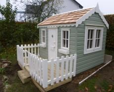 Childrens playhouse with decked playarea