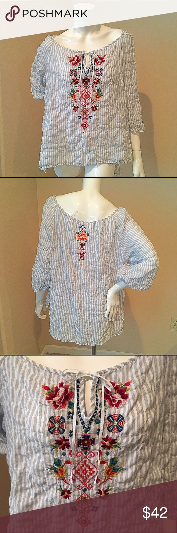 Johnny Was XL puckered peasant embroidered blouse Johnny Was extra large puckered striped embroidered peasant blouse. 44% rayon 55% cotton 1% spandex. Bust 21 inches, sleeve 17 inches, length 25 inches. Johnny Was Tops Blouses