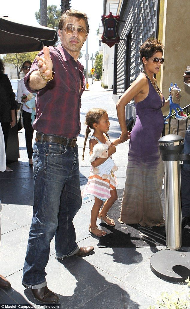Don't come any closer: Olivier Martinez showed his protective side when he took pregnant Halle Berry and her daughter to a Mother's Day lunch on Sunday