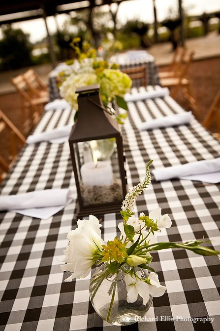 Southern wedding details- checkered table cloth and handpicked flowers Image by Richard Ellis Photography