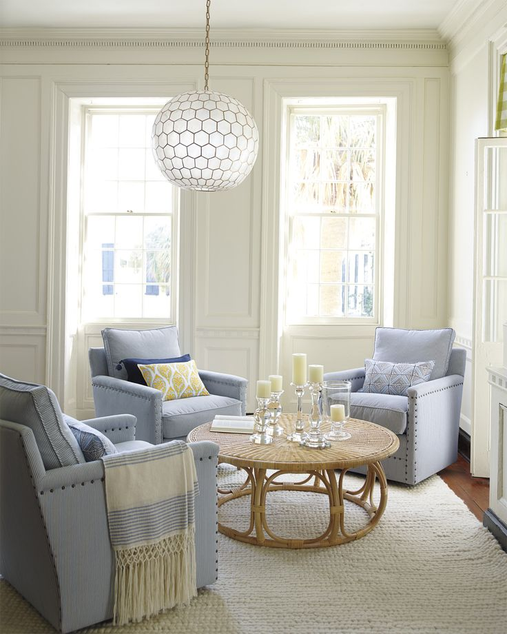 A cozy living room nook | Anguilla Rattan Coffee Table and Magnolia Pillow Cover via Serena & Lily