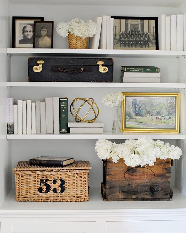 We filled the shelves in the back hall with some family pictures, more of those covered books, and a few second-hand finds. You can see more images and a detailed source list on the blog (link in profile). - JD
