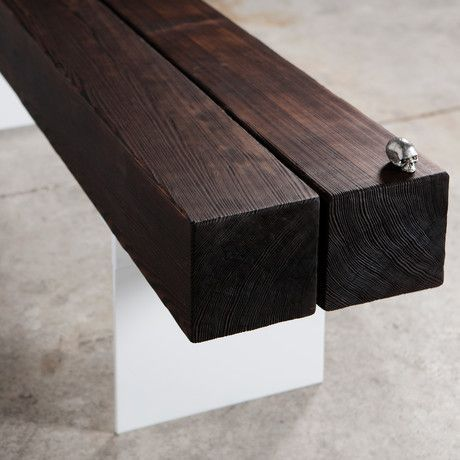"""Wood and steel combine in this striking industrial bench. Cedar treated to Japanese art of burning, called shou sugi ban, is carefully charred to create a beautiful protective natural finish. The .25"""" steel plate legs of the bench are painted white in beautiful contrast to the wood's dark beauty.:"""