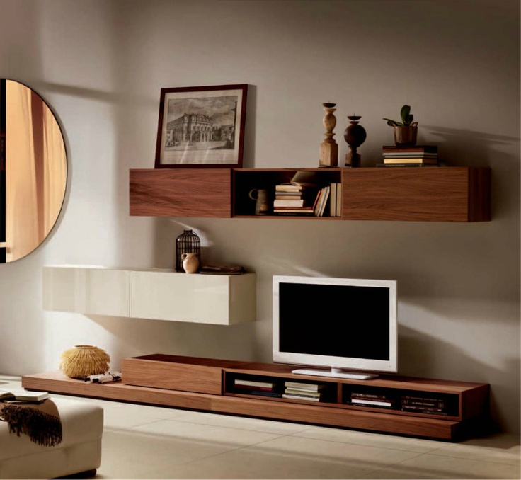Natuzzi wall unit, I like the assymetrical placement of the wall units, I think this would work with black and white glossy units. I would prefer this without so much stuff on the wall units, maybe one or two carefully chosen items.