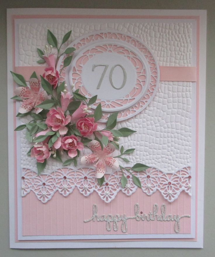 Card made for a special friend's 70th Birthday.  I've used two of Sue Wilson's dies... Frames & Tags - Grace and from the Gemini Collection - Corvus.  The leaves are memory Box Fresh Folliage and the flowers are my own PENNYs PRIDE, some little lillies and Tea Roses.