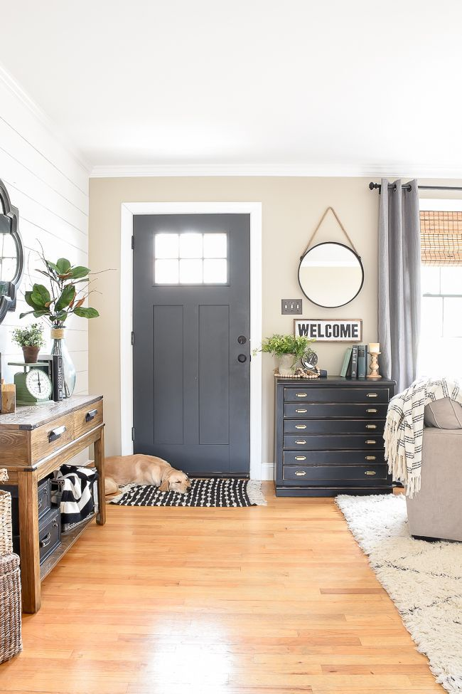 A beautiful modern farmhouse entryway in a small ranch style home. Accent door to pop against the accent wall. #DIYHomeDecorKitchen