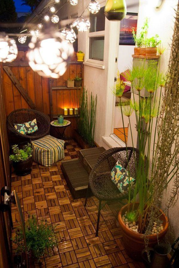 An interesting wood themed apartment balcony décor. You can see that the spaces are filled with furniture however it does not look cluttered. The wooden walls and floor compliment with the theme as well as the organic themed chairs and scented candles.