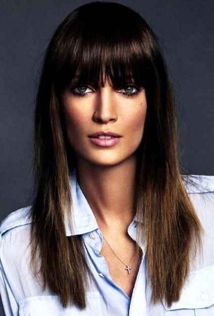 This straight hair style with long bangs is totally glam.