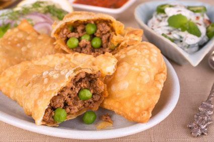 Samosas are the ultimate street food. Crisp, light pastry parcels of spicy meat or vegetables make great snacks when you need a burst of