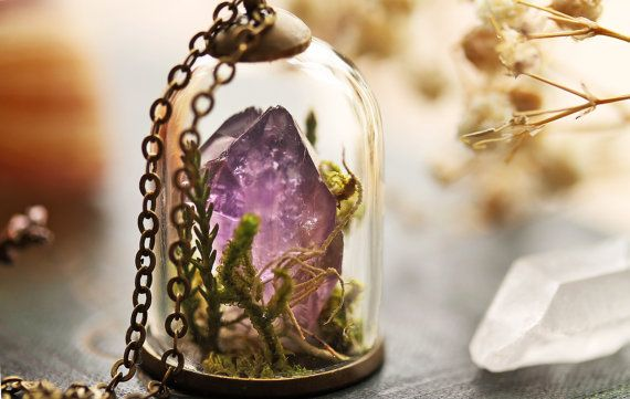 A beautiful raw Uruguay Amethyst crystal has been nestled into a bed of real Irish woodland mosses and lichens under a tiny glass bell-jar to