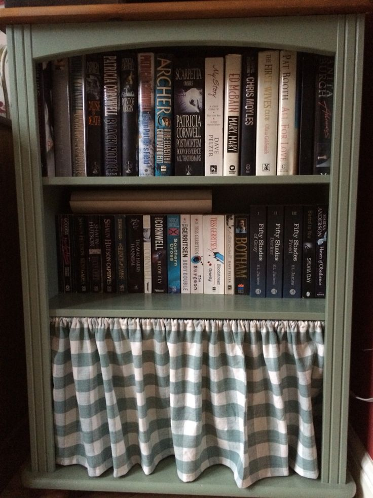 Upcycled bookshelf,I added the curtain to hide the wii games & controllers.