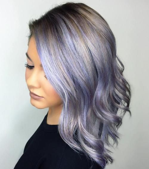 Pastel Purple Hair With Brown Roots | #36: Layered Lavender Curls. This pretty hairstyle is a great option for full faces. Side part your hair and tuck the smaller part behind the ear. And we cannot forget about the color: this combo of lavender, steel grey, and ash brown is gorgeous!