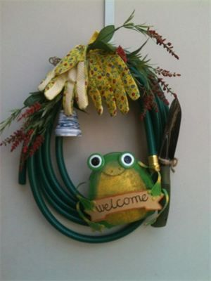 18, Garden Hose Wreath with Frog, Spade & Gloves by Red-y Made Wreaths. Like us on Facebook https://www.facebook.com/pages/Red-y-Made-Wreaths/193750437415618 or Visit at www.redymadewreaths.com