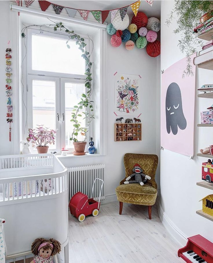 Use toys and accents to add colour to an all-white kid's room