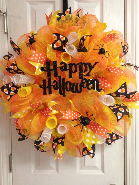 this 27 deco mesh wreath will be a cute addition to your halloween decor it is adorned with little glittery black spiders polka dot and candy corn ribbons - Candy Corn Halloween Decorations
