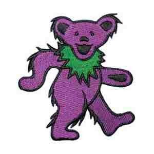 """Grateful Dead - Purple Dancing Bear Embroidered Patch $3.99  This Grateful Dead patch is a little purple dancing bear with a green collar. Put this guy on a backpack, hat, jacket, or jeans. Embroidered patches can be ironed on or sewn on.  Officially licensed Grateful Dead merchandise. Approximate size is 2"""" ."""