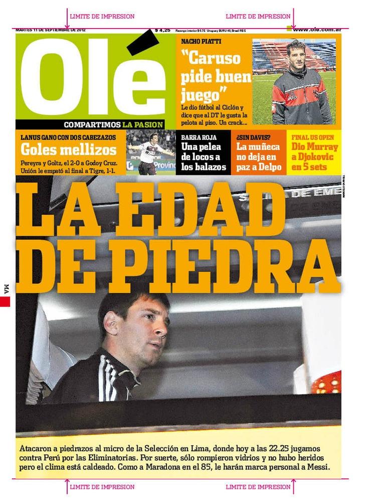 """TAPA del Diario """"Olé"""" sobre el lanzamiento de piedras al bus de la selección argentina."""