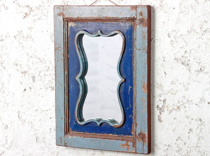 This attractive ornate blue wall mirror would be an excellent choice for any lonely wall. Its embossed profiled mirror frame and a two-tone colour scheme reflect its North Indian origin. #vintage #mirror #unique #furniture #homedecor #homestyle