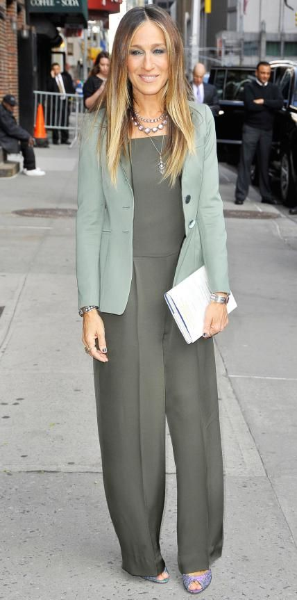 Sarah Jessica Parker in an olive green jumpsuit and a muted moss blazer