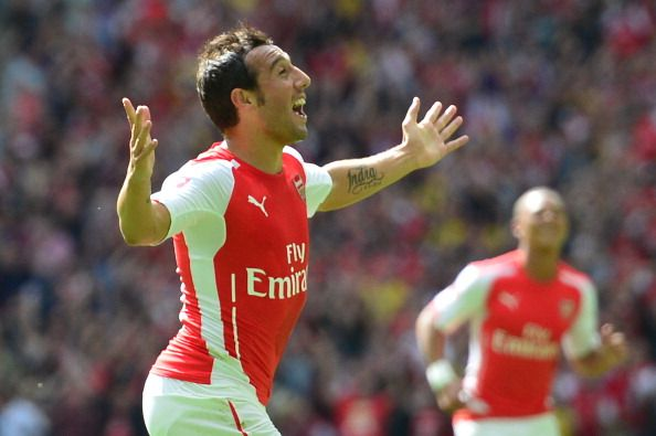 Arsenal's Spanish midfielder Santi Cazorla (L) celebrates scoring the opening goal during the FA Community Shield football match between Arsenal Manchester City at Wembley Stadium in north London on August 10, 2014.