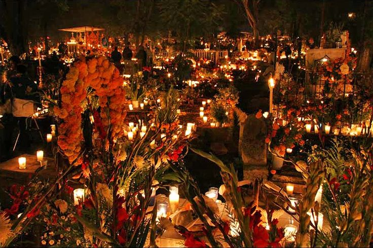 Day of the Dead - Cemetery in Mexico City. It's customary for the family to spend several days cleaning and decorating the graves of the dead with candles, flowers, skulls, food, and photographs. (photo courtesy of Saturn Satori)