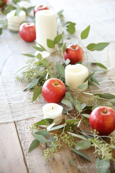 Create a 5 minute holiday table centerpiece using apples, pillar candles and eucalyptus, with this simple tutorial for beginners! Perfect for holiday entertaining!