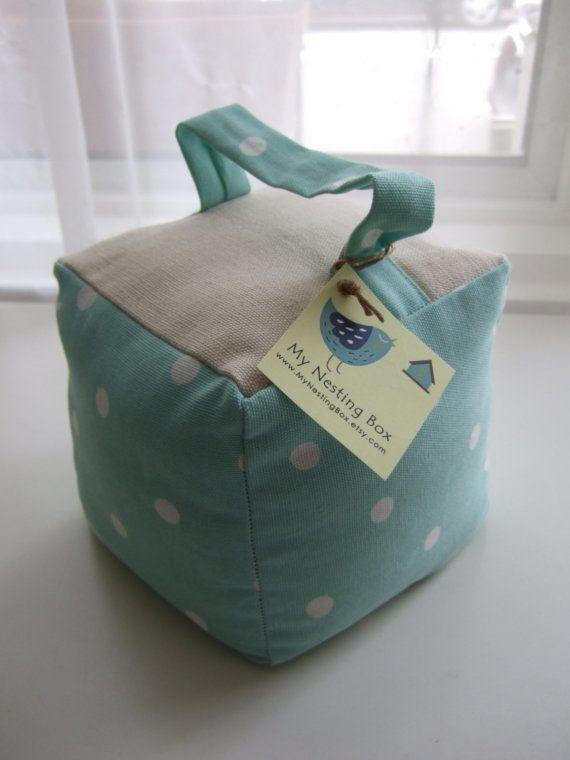 sweet duck egg blue polka dot handmade fabric door stop for the baby room
