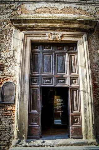 An old church door in  Arezzo Italy.