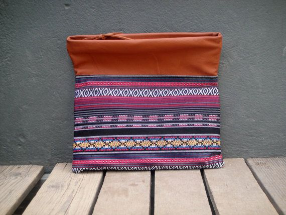 Check out this item in my Etsy shop https://www.etsy.com/listing/236613178/boho-clutchimpregnated-colorful-fabric