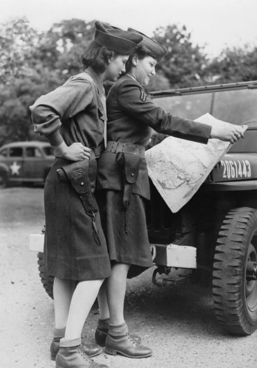 WAC Private Theresa Smith and Corporal Fay Zimmerman consulting a map while on duty at the Eight Air Force base, c. 1944