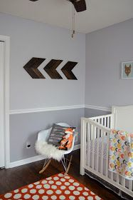 Woodland Nursery~THIS is Exactly what I was thinking Devin! Grey walls dark floor white woodwork and orange accents :) YUP!    also LOVE the arrow design on the wall, Modern. Cute fox pillow