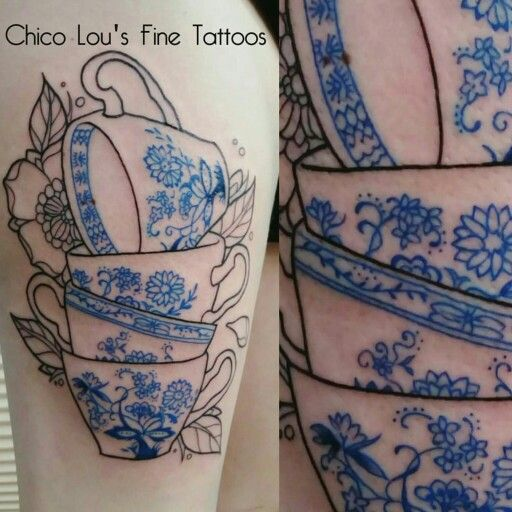 Tea cup outline tattoo with blue ink and flowers, more to come