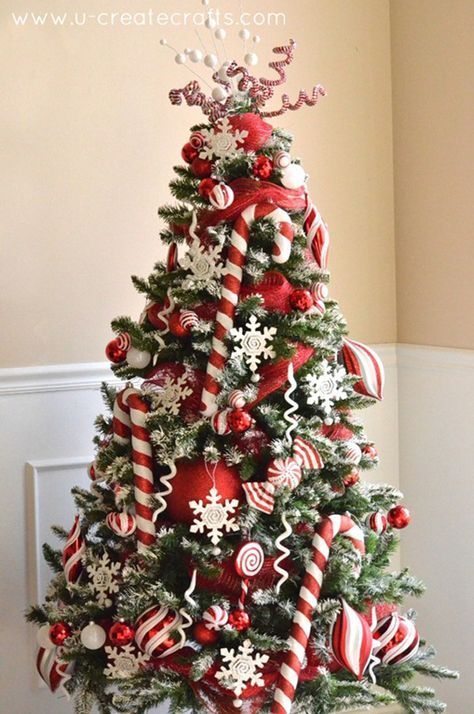 Peppermint Snow Candy Cane Christmas Tree. See 15 Amazing Christmas Tree Ideas on www.prettymyparty.com.