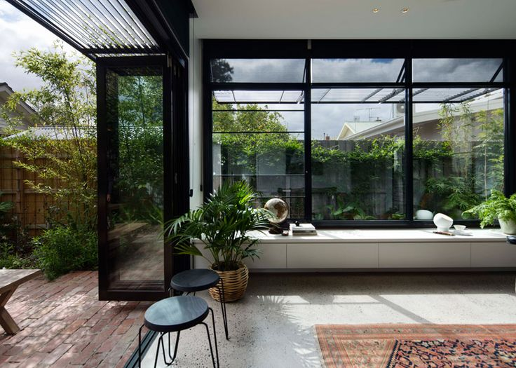 Melbourne Garden Room is a blackened wood extension to a century-old Edwardian house.