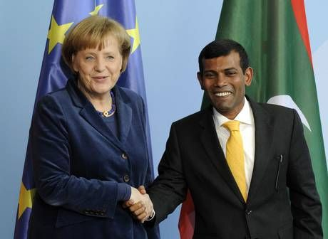 Angela Merkel with the former president of the Maldives, Mohamed Nasheed, in 2010 (AFP/Getty Images)