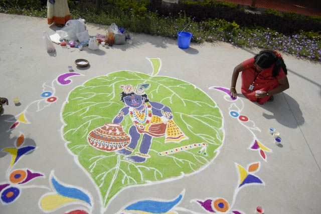 Amazing baby Krishna steals butter rangoli (rice flour paste) decoration for Janmastami celebrations. How awesome!