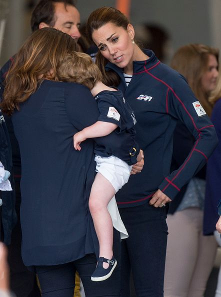 Catherine, Duchess of Cambridge meets staff and families at the Ben Ainslie Racing team base as she attends the America's Cup World Series event on July 26, 2015 in Portsmouth, England.