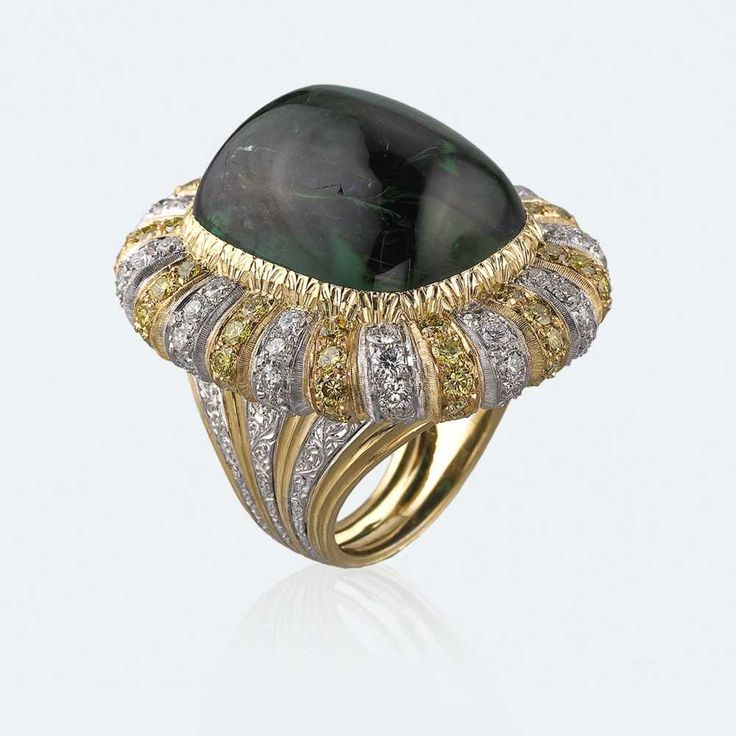 Cocktail ring with dark green tourmaline enhanced by the luminous alternation of the yellow and white of both gold and diamonds. Among the most precious stones, it enchants with its multicoloured nature whose spirit is joyful and highly luminous. The tourmaline embodies the beauty and variety of earth itself, with all the energy and vitality it instils in whoever wears it. Http://www.facebook.com/diamonddreamfinejewelers http://www.twitter.com/diamond_dream_