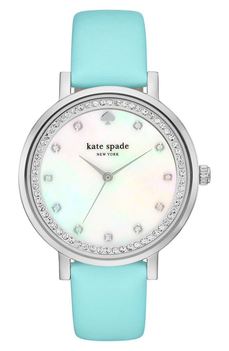 How gorgeous is this turquoise leather strap watch from Kate Spade? Sparkling crystals mark the hours and ring the mother-of-pearl dial for an elegant look.