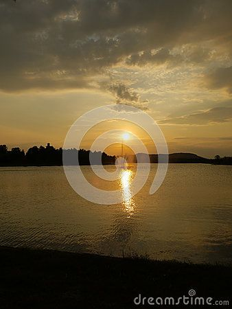 Sunset over a lake and water fountain in the city of Boden, Sweden.