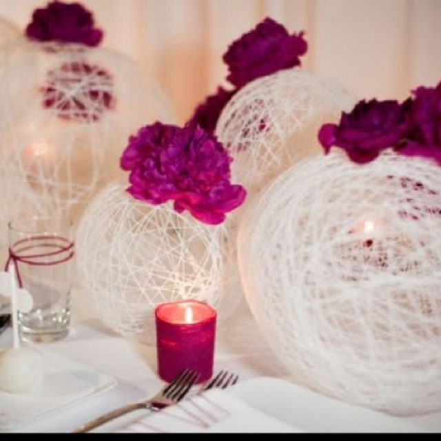 DIY wedding decor.  - You need a balloons, a needle, string (yarn), bowl of water, glue.. 1. make your watered down glue in a bowl 2. spray the balloon with cooking spray so the string will come off easily 3. take the string and dip it in the bowl... 4. wind the string around the balloon until it's covered to your liking/design 4. let it set/dry and pop the balloon :D